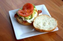 Egg sandwich with tomato, avocado and bacon.