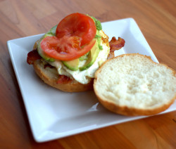 Egg sandwich with tomato, avocado and bacon.